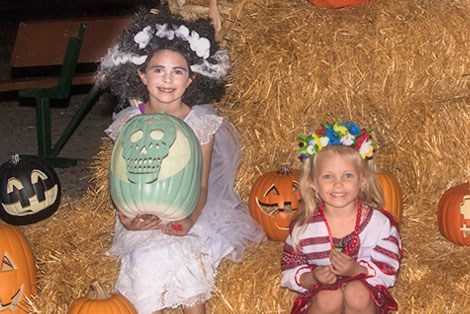 kids having fun at trail of jack o lanterns halloween event green meadows farm orlando